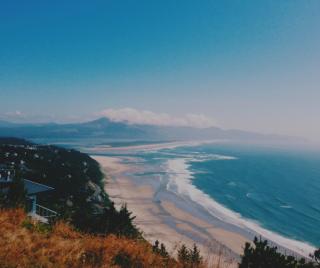 A beach, mountain, and ocean surf