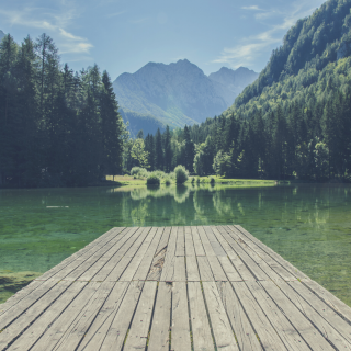 Dock on a peaceful lake with a mountain background