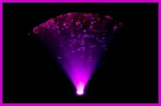 A colourful fiber optic lamp in the dark.