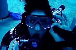 Ayisha in SCUBA gear in the ocean