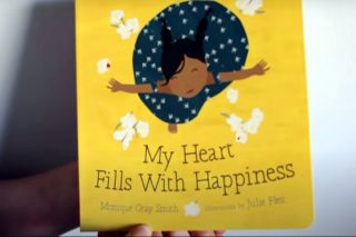 'My Heart Fills With Happiness' book held by author Monique Gray Smith